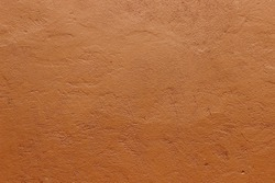 Dark terracotta plaster rough wall texture background