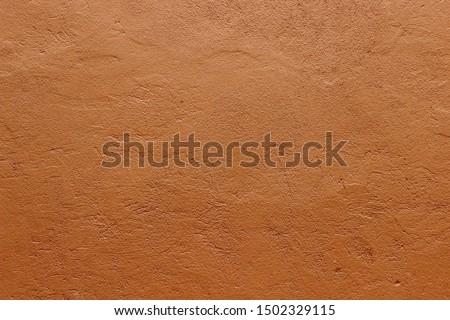 Dark terracotta plaster rough wall texture background  Photo stock ©