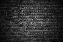 Dark texture of stonewall. Briks from stones and cement lines