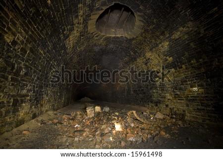 Dark Tunnel ventilation shaft. Underground Light painting in disused