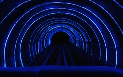 Dark tunnel with blue light lines in the form of an arch