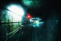 Dark underground tunnel. Grunge processed image with special grain and texture for more dramatic view