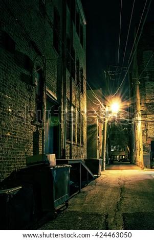 Dark Urban Alley at Night #424463050