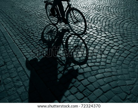 Dark urban cyclist  on his way home after work - Denmark.