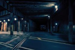 Dark urban downtown city train tunnel at night.