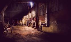 Dark vintage  back yard with graffiti