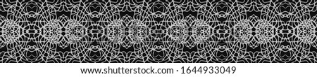Dark Vintage Repeat Pattern Tile. Ornate Tile Background Ornate Tile Background Black Silver Dressing element Indian Tribal Art. Royal Kaleidoscope Effect. Floral Design. Floral Design.