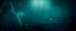dark web hooded hacker  in his den