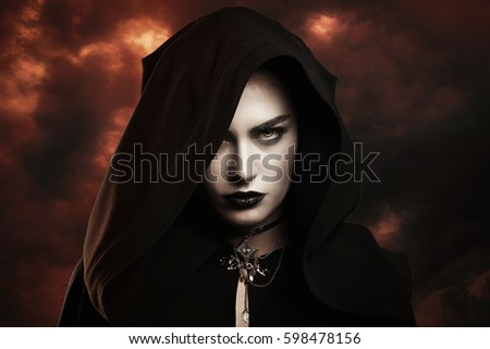 Dark witch with hellish sky . Doom's day concept #598478156