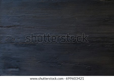 Dark wood background surface with old natural pattern or wood table top view. Grunge surface with wood texture background. Vintage timber texture background. Rustic. Balck texture