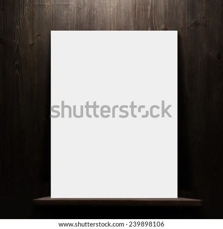 dark wooden background texture.wall with shelf and blank poster