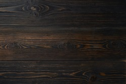 Dark wooden background with a pine wood, structure of wood with knots