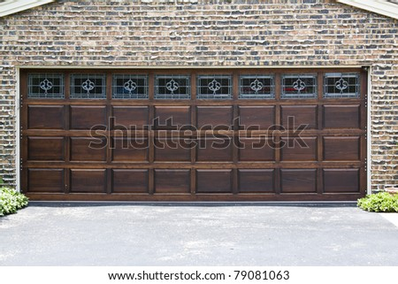 Dark Wooden Garage Door with brick wall background