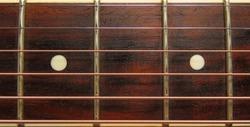 Dark Wooden guitar fretboard background