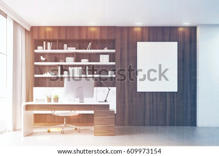 Dark wooden workplace with a table, a desktop standing on it and a bookcase behind it. Poster on the wall. 3d rendering. Mock up. Toned image