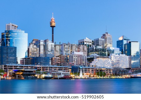 Photo of  Darling Harbour cityscape and promenade with Christmas tree. Holiday season Sydney cityscape