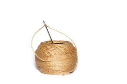 Darning Needle and ball of thread isolated on a white Background. Home repair and sewing kit.