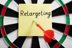 Dart And Arrow With Retargeting Word On Sticky Note