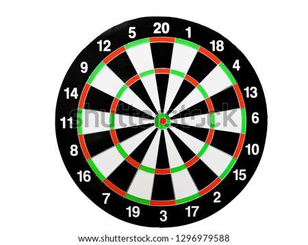 Dart arrow hitting in the target center of dartboard. Success hitting target aim goal achievement concept background.Darts and dart board.Close up shot of the dart arrow.Marketing concept. Dartboard.