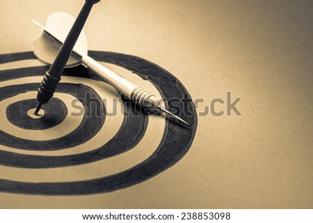 Dart hit on the center of sketching dartboard