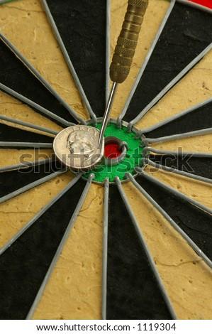 Dart hitting a quarter bulls-eye