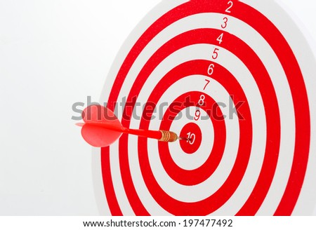 Dart Hitting A Target, Isolated On White Background