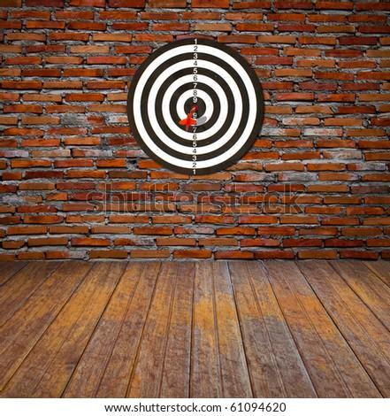 Dartboard on brick wall (Darts Hit Target) #61094620