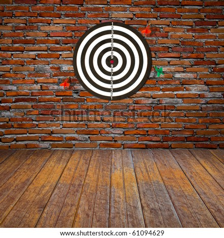 Dartboard on brick wall (miss darts) #61094629