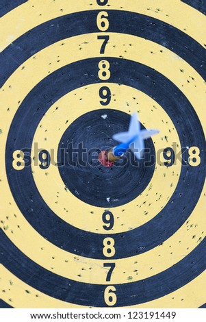 Dartboard with arrow in the bullseye