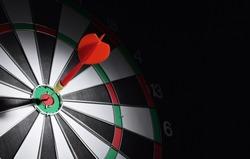 Dartboard with dart arrow hitting the center. Marketing concept.