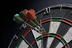 darts. 3 darts in triple 20. Black background