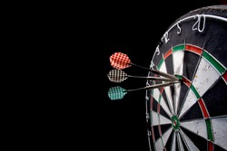 darts. 3 darts in triple 20. Black background. 180