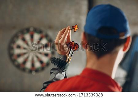 Darts game. Dart and target. Stockfoto ©