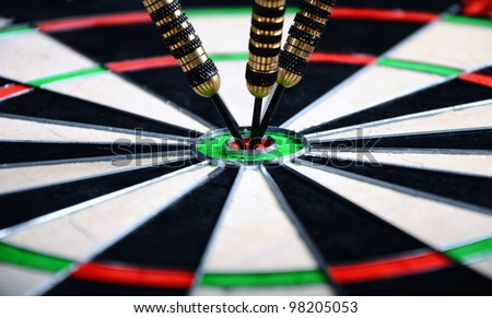 darts hit the target in bull