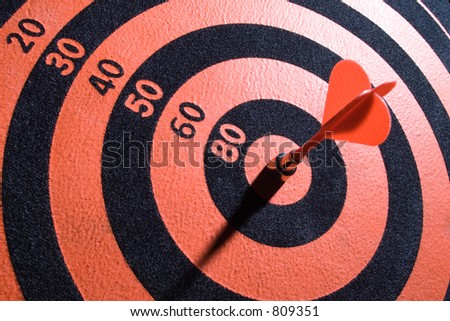Dartsboard with arrow in center.