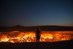 Darvaza, Turkmenistan - Staring into the flaming gas crater known as the Door to Hell In Darvaza, Turkmenistan.