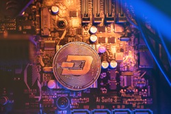 Dash Cryptocurrency coin on a PC computer motherboard, crypto currency mining concept.