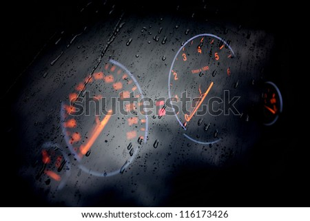 dashboard car through wet glass - stock photo