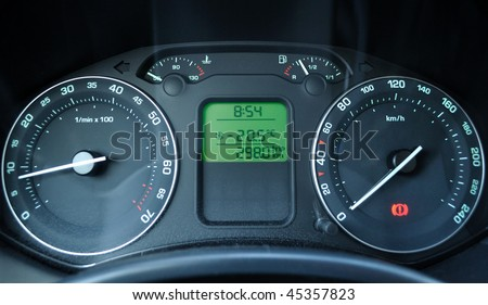 Dashboard of a car in winter freezy times. The thermometer is showing - minus 20 Celsius (- minus 68 Fahrenheit).
