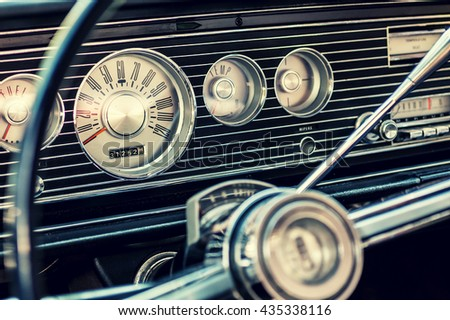 Dashboard of a classic american car from the 1960's.