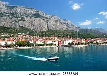 dashing motorboat on makarska riviera, croatia