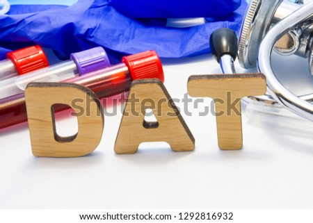 DAT abbreviature mean direct antiglobulin test with lab tubes with blood and stethoscope. Using acronym DAT in laboratory clinical diagnosis, presence in human blood of antibodies.