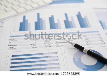 Data Analysis. Pen with business report on financial advisor desk. Concept of business planning , accounting, analysis, business analysis,financial services,financial planning,