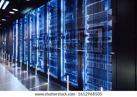 data center in server room with server racks