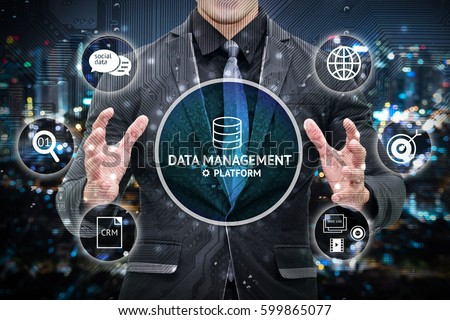 Data management platform and future marketing concept.  Man business suit hand , Electric circuit graphic and info graphic of dmp technology icons. #599865077