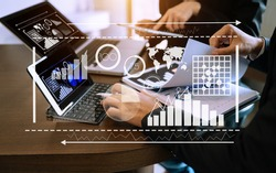 Data Management System with Business Analytics concept. business team hands working with provide information for Key Performance Indicators and marketing analysis onn virtual computer