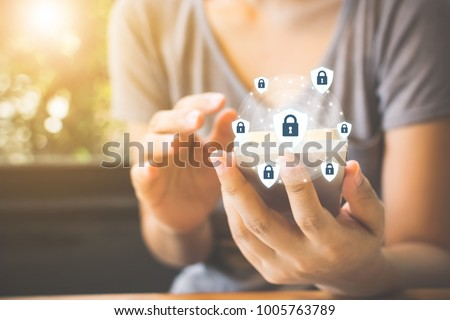 Data protection and security important information in your mobile phone, Woman hand using smartphone and icon key on shield Сток-фото ©