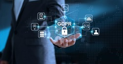 Data protection privacy concept. GDPR. EU. Cyber security network. Business man protecting his data personal information. Padlock icon and internet technology networking connection on virtual screen
