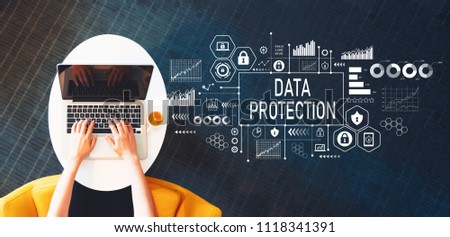 Data protection with person using a laptop on a white table #1118341391