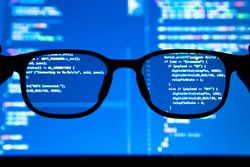 Data scientist , big data , artificial intelligence , machine learning technology concept. Silhouette glasses in front of laptop computer screen with programming coded.